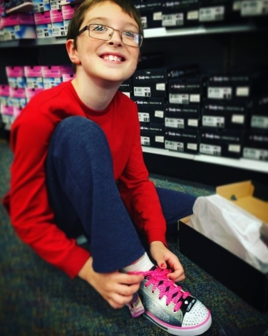 trying on his twinkle toe sneakers