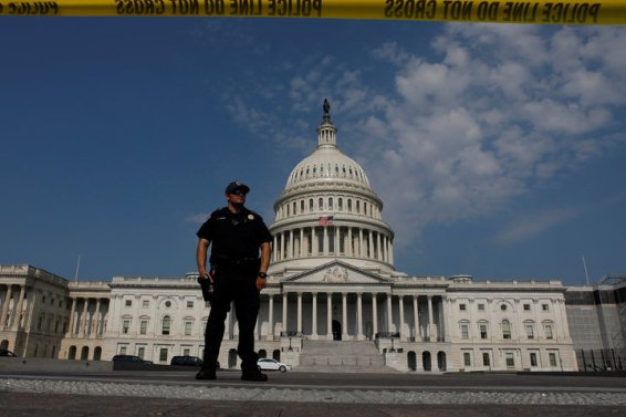 U.S. Capitol Police keep watch on Capitol Hill following a shooting in nearby Alexandria, in Washington