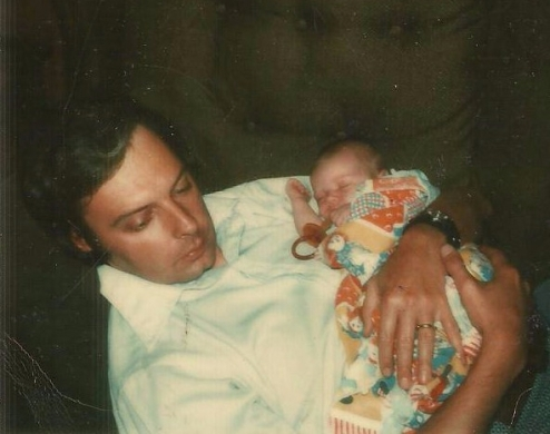 Dad holding newborn me