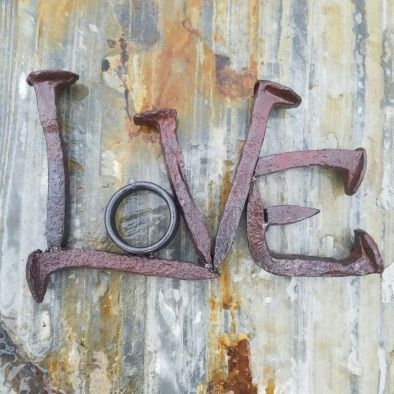Railroad spikes spelling LOVE