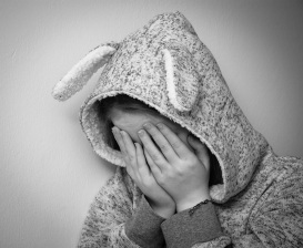 Sadd kid - hiding face
