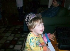Charlie, age 2, wearing a crown that mom won during Divas! at Raleigh Little Theatre